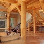 Timber Frame Great Room with Fireplace and Treeform Post