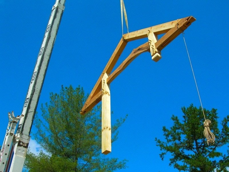 Get Heard at TimberFrameHQ! Crane hoisting a bent