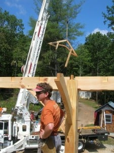 flying in a timber hammer beam truss on raising day