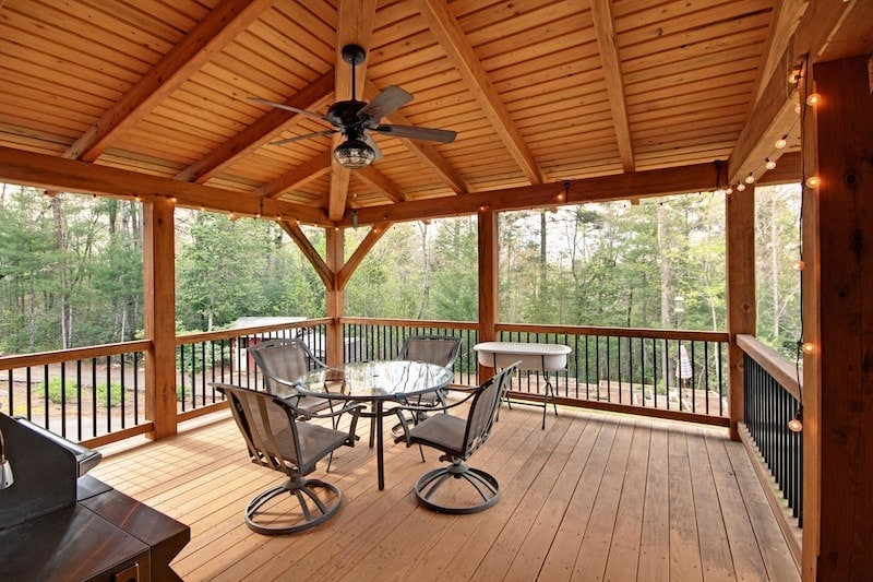 10 reasons to cover your timber frame deck for Timber frame porch designs