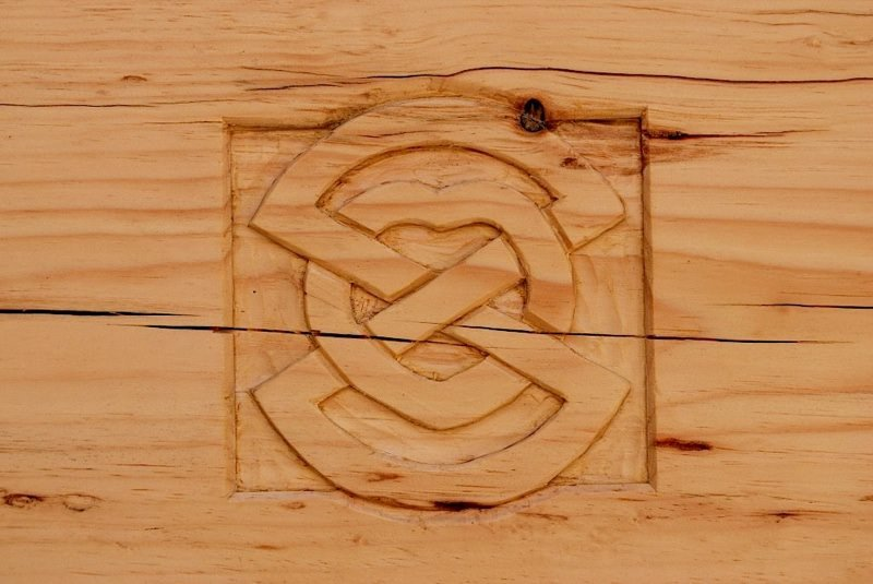 Gillis & Company carved logo