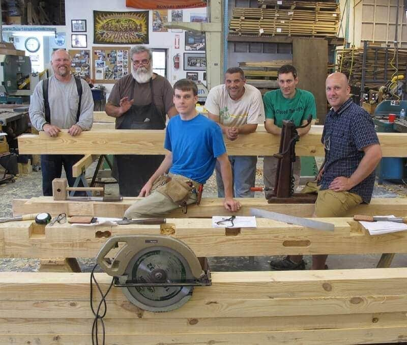 Workshop class in North Carolina with student and timbers 2014.