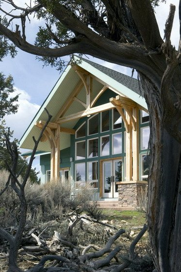 Exterior, vertical, rear elevation. Burnett residence. Mountain Timber Design, Riverbend Timber Framing.