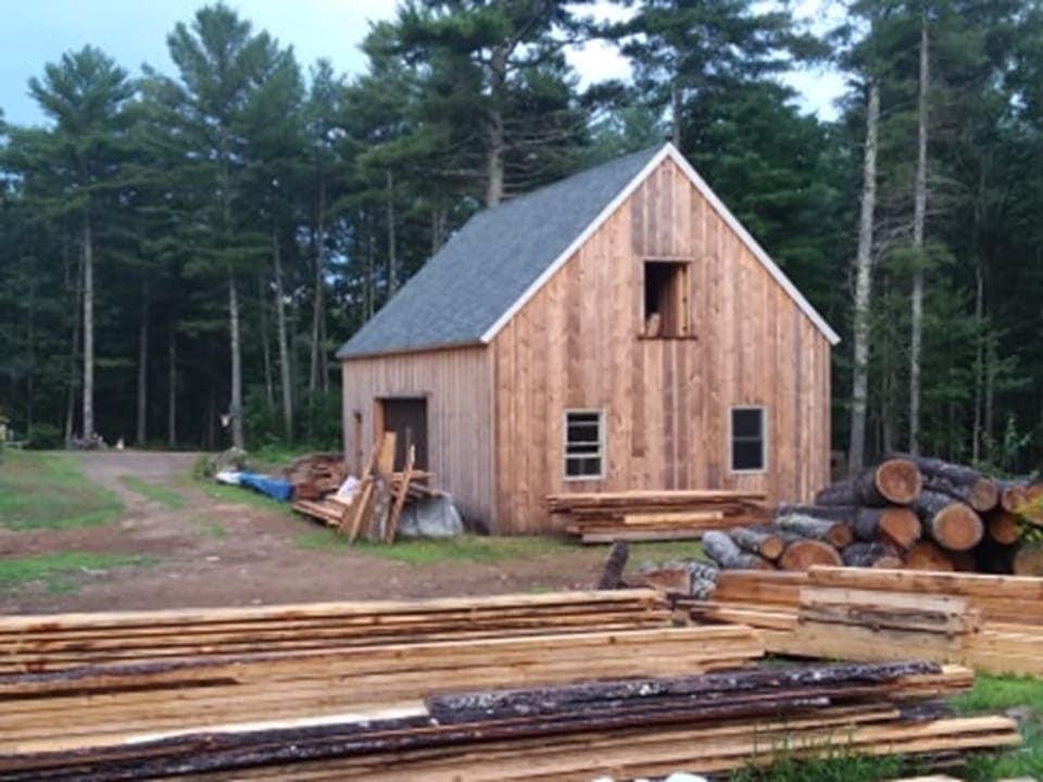 Dostie queen post four bent barn